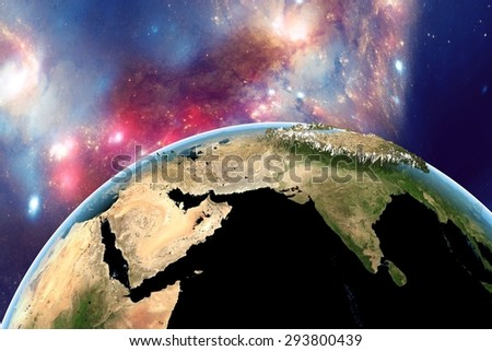 Planet Earth on background with stars and galaxies; the Earth from space showing India, Himalayas, Arabian peninsula on globe in day; with enhanced bump; elements of this image furnished by NASA - stock photo