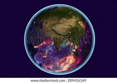 Planet Earth on background with stars; the Earth from space showing India, Arabian peninsula, Russia on globe in the day time; galaxies are reflected in water; elements of this image furnished by NASA