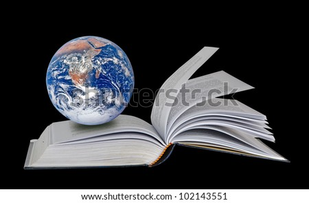 Planet Earth on book.Elements of this image furnished by NASA - stock photo