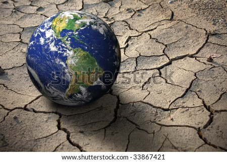 Planet Earth on dry soil, photo of the earth from nasa - stock photo