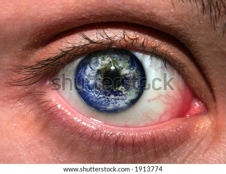 "Planet Earth reflected in a woman's eye: ""Save the Earth"", environmental safety and conservation concept"