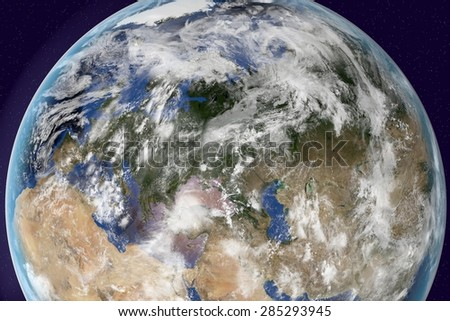 Planet Earth; the Earth from space showing Europe, Asia and Africa on globe in the day time with clouds; elements of this image furnished by NASA