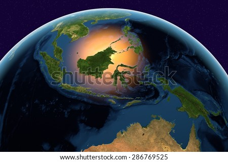 Planet Earth; the Earth from space showing Indonesia on globe in the day time; elements of this image furnished by NASA - stock photo