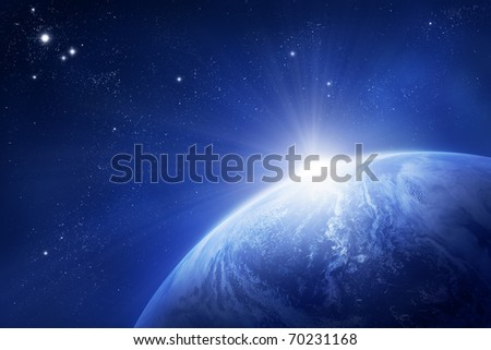 Planet Earth with rising sun in space - stock photo