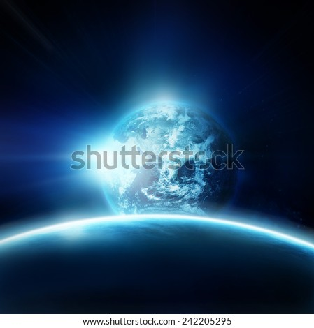 Planet earth with sun rising from space- Elements of this image furnished by NASA  - stock photo
