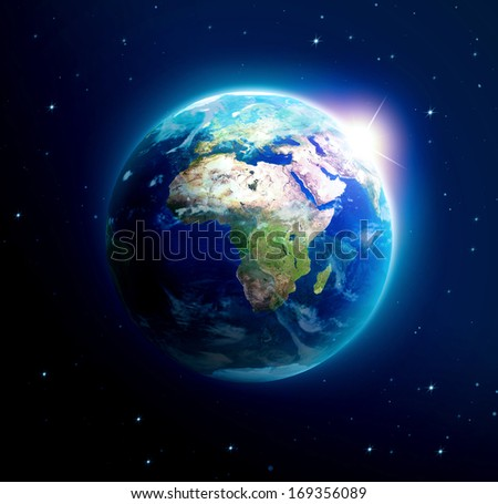 Planet earth with sun rising over Asia (Elements of this image furnished by NASA) - stock photo