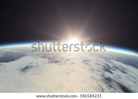 Planet Earth with sunrise in space (Elements of this image furnished by NASA) - stock photo