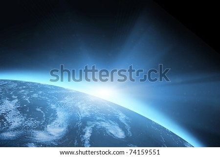 Planet earth with sunrise in the space - stock photo