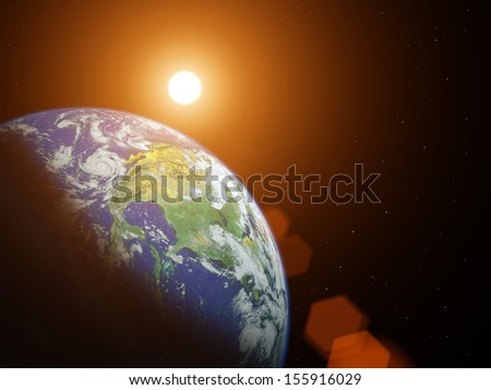 Planet earth with sunrise in the space. Elements of this image furnished by NASA - stock photo