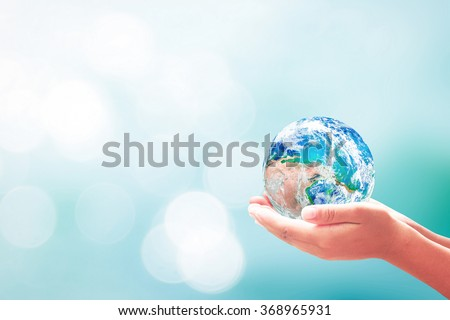 Planet in human hands. Water CSR Ocean Autism Awareness Rethink Reduce Reuse Recycle Refuse Return Life Give Job Trust Help Global Fresh Idea Peace Hold Globe. Elements of this image furnished by NASA - stock photo
