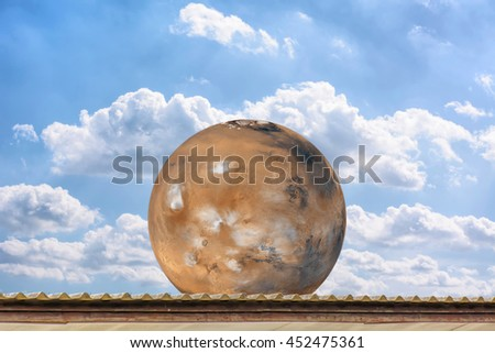 Planet Mars on the roof, on the blue sky. Elements of the furnished by NASA.