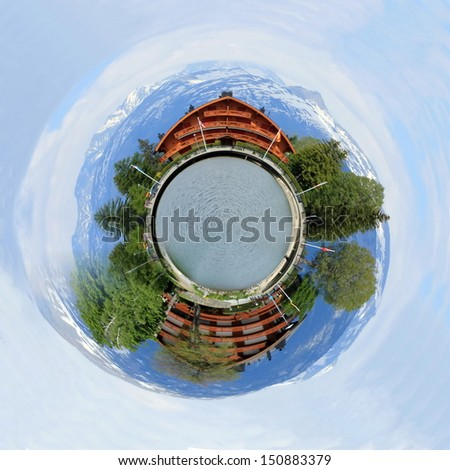 Planet with swiss chalet, Long lake and Alps mountains in summer, Crans Montana, Switzerland
