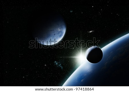 Planets with sunrise in space - stock photo