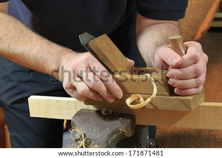 planing a wooden strip with a planer