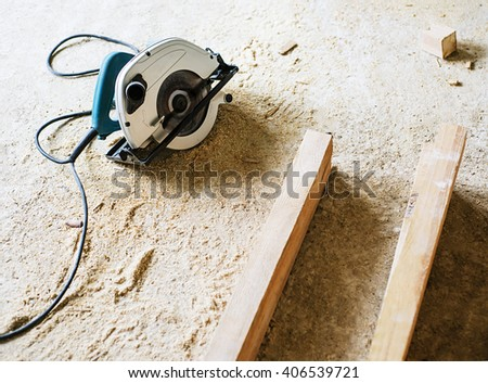planks and saw, circular saw with sawdust and boards, electric saw - stock photo