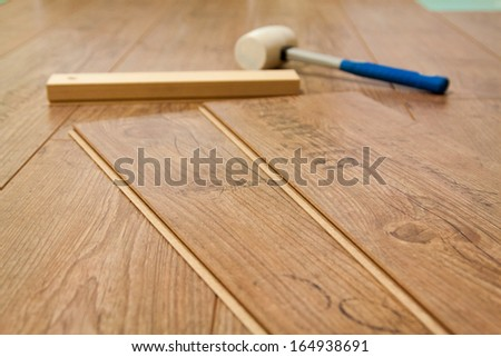 Planks of laminate floor and tools to install them - stock photo