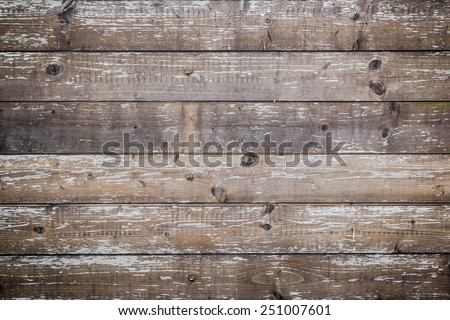 Planks of wood damaged by the aging process. - stock photo