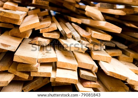 Planks of wood stacked - stock photo