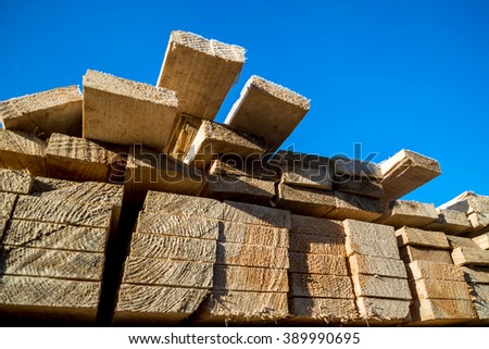 Planks packed against the sky - stock photo