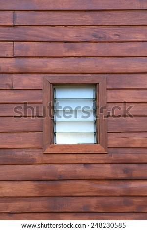 Planks wall with glass window - stock photo