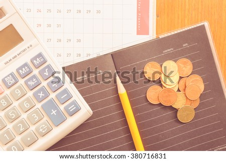 planner and money with vintage color concept - stock photo