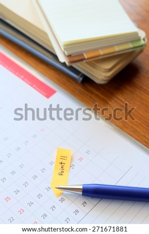 planner and note paper on wooden table