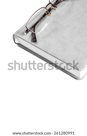 Planner with glasses on a white background isolate.