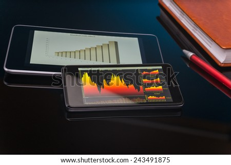 Planning and analyzing graphs with table pc - stock photo