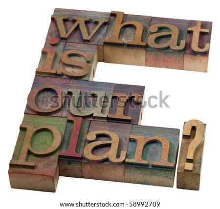 planning concept - what is our plan question in vintage wooden letterpress printing blocks, stained by color inks - stock photo