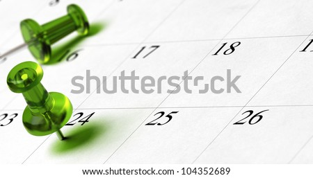 planning document with green thumbtack pushed on the number 24 with room for text and blur effect - stock photo