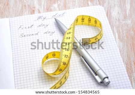 Planning of a diet. A notebook with inscription - My Diet, a measuring tape and pen - stock photo