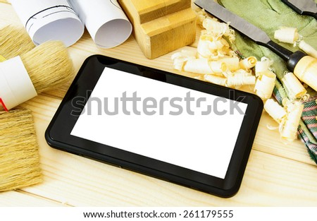 Planning of construction of the house. Joiner's works. Woodworking. Tablet, drawings and working tools on a wooden background. - stock photo
