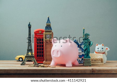 Planning summer vacation, money budget trip concept with piggy bank. - stock photo