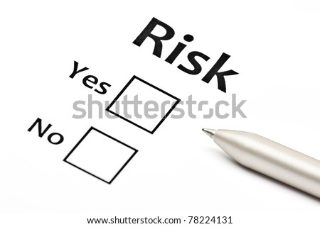 planning the business risk with pen at work - stock photo