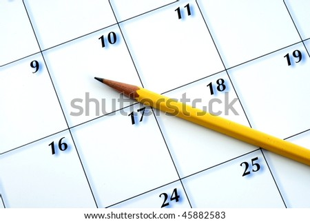 Planning the new month from a calendar with a pencil