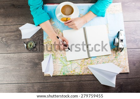 planning travel for a cup of coffee. Empty space in a notebook for blog entries, you can place your text or information. Top view