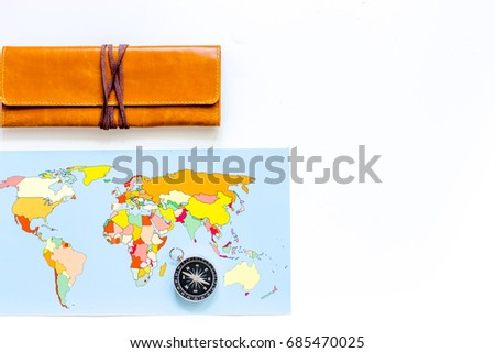 Planning trip. World map and compass on white background top view copyspace
