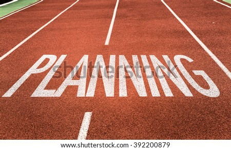 Planning written on running track
