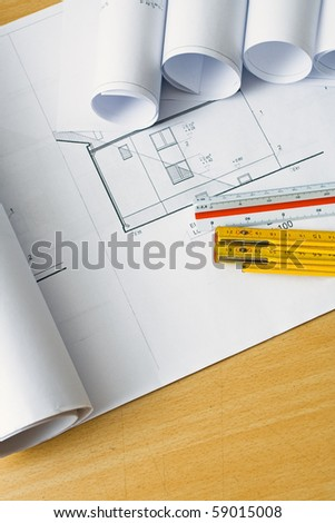 Plans and architect blueprints of housing project on a desk - stock photo