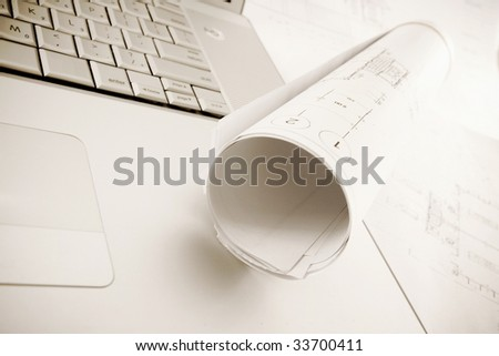 plans and laptop - stock photo