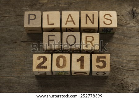Plans for 2015 on a wooden background - stock photo