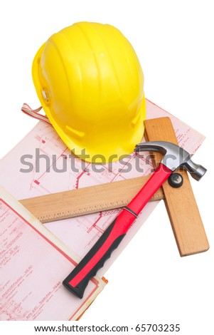 Plans of the house with hammer, helmet and wooden ruler, isolated on white - stock photo