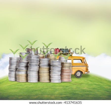Plant growing out of coins with miniature car - stock photo