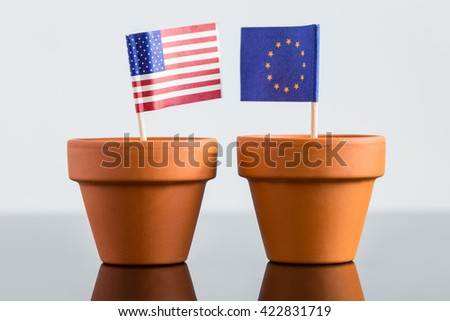 plant pot with european and usa flag, concept population increase, FTA or nato