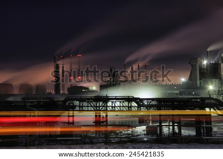 Plant, smog at night - stock photo