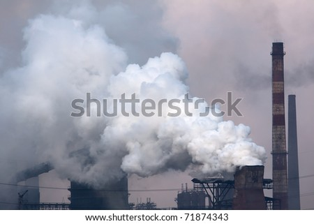 Plant with smoke. Air pollution - stock photo