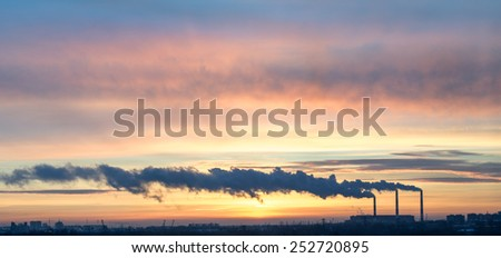 Plant with smoke on break of day. industrial city - stock photo
