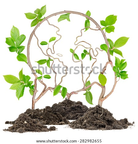 Plants growing from soil heaps forming Earth - stock photo