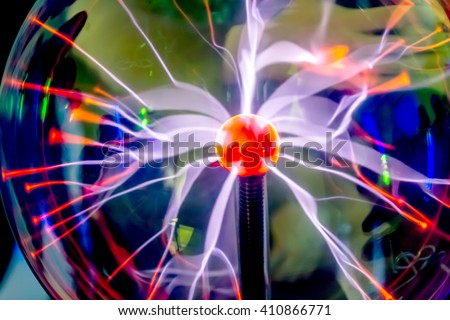 Plasma Ball with purple blue light. Tesla's energy sector. The bulk electrical energy in space. Popular scientific physical experience. Physical Laboratory - stock photo