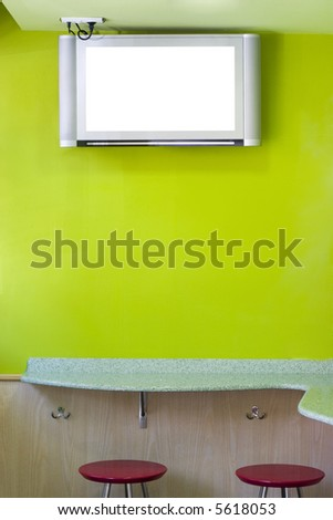 plasma television set hung in a coffee shop - stock photo